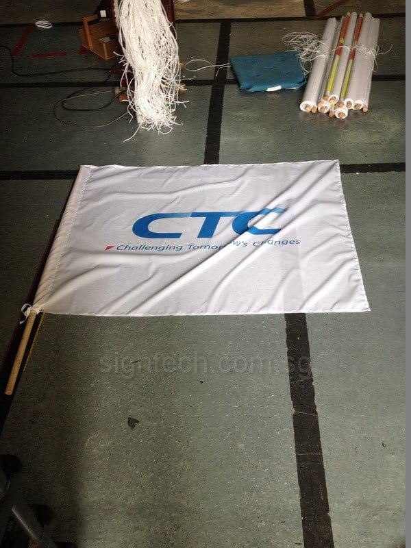Flag with wooden pole