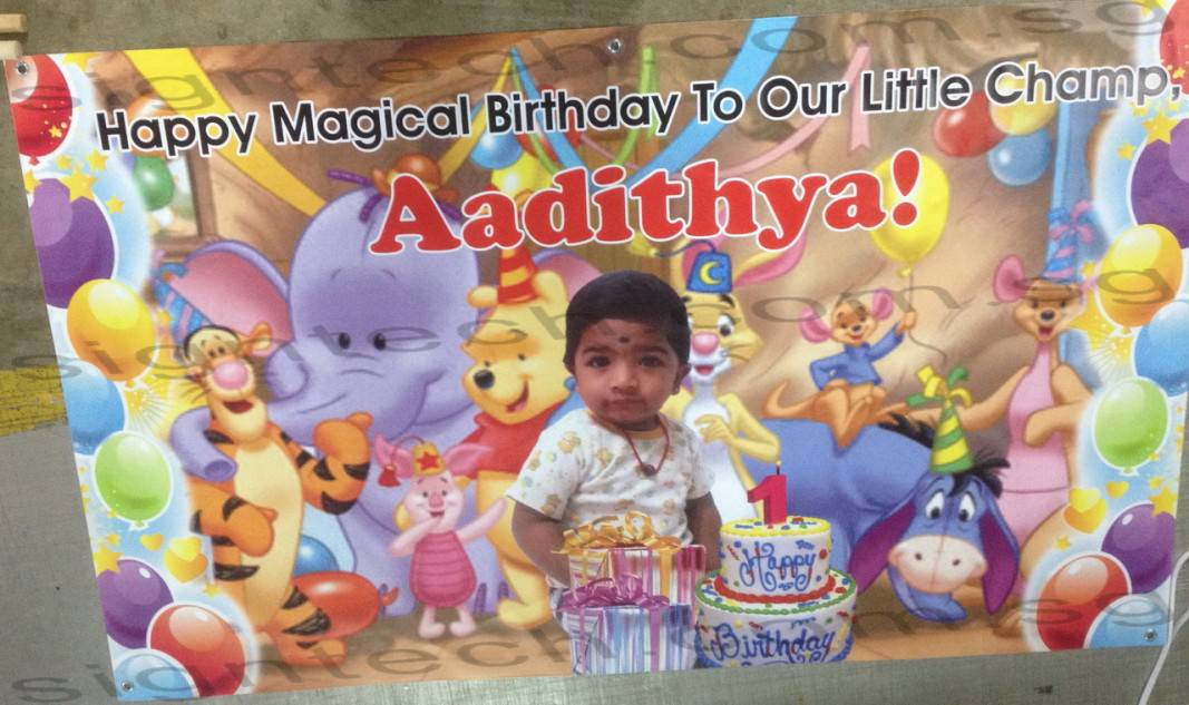 birthday banner with winnie the pooh and real cake design